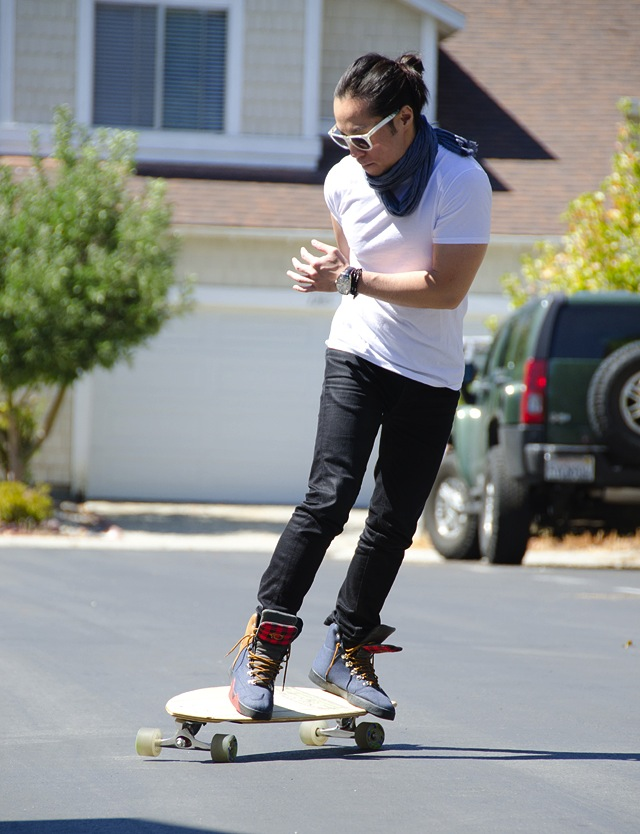 patrick-ng-riding-skateboard-in-nudie-jeans
