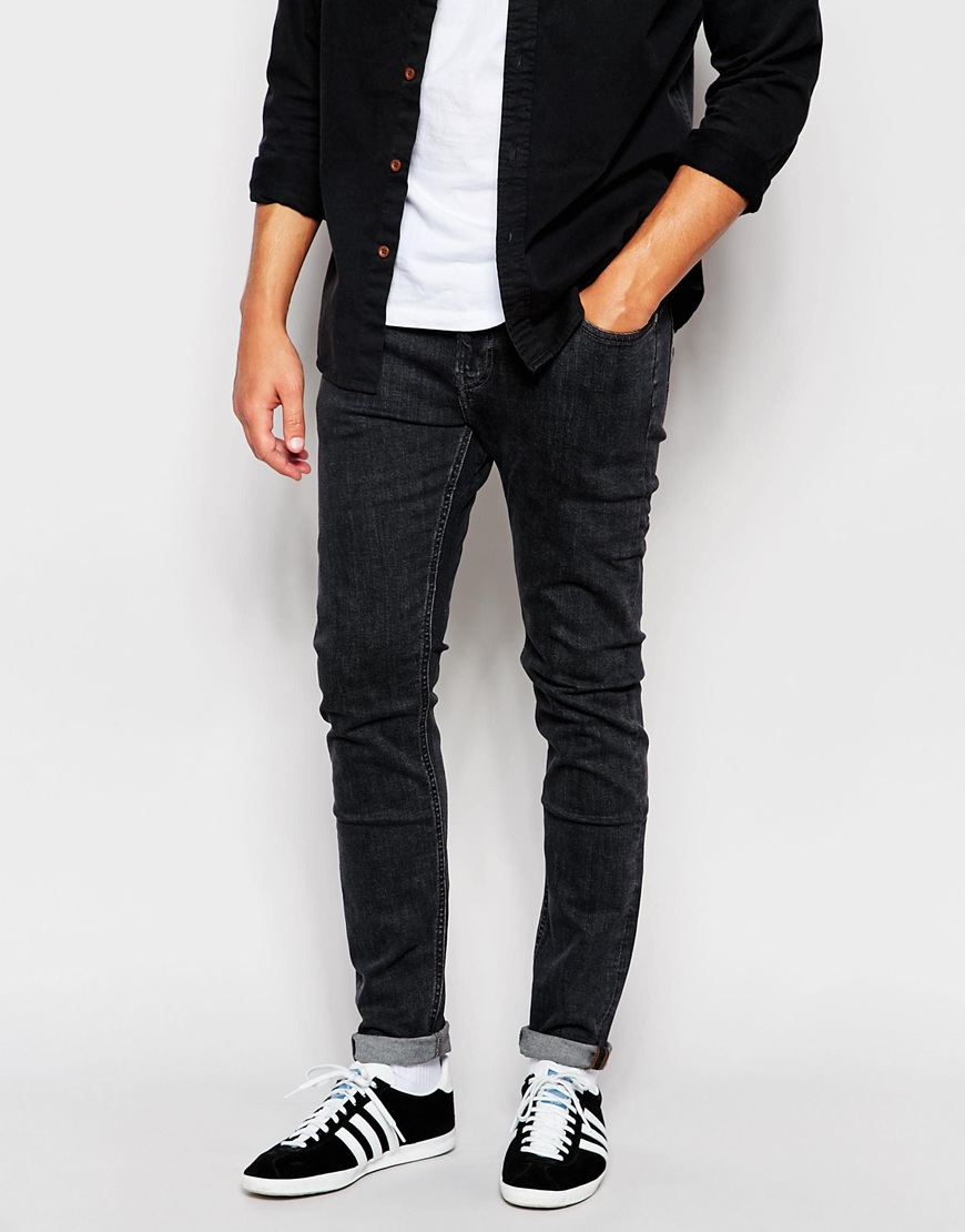 Black skinny jeans work well with everything from simple T-shirts and sneakers to silk tank tops and dress boots. White jeans or lightweight jeggings are perfect for warmer months. Look to Denim & Supply Ralph Lauren and MICHAEL Michael Kors for sleek styles.
