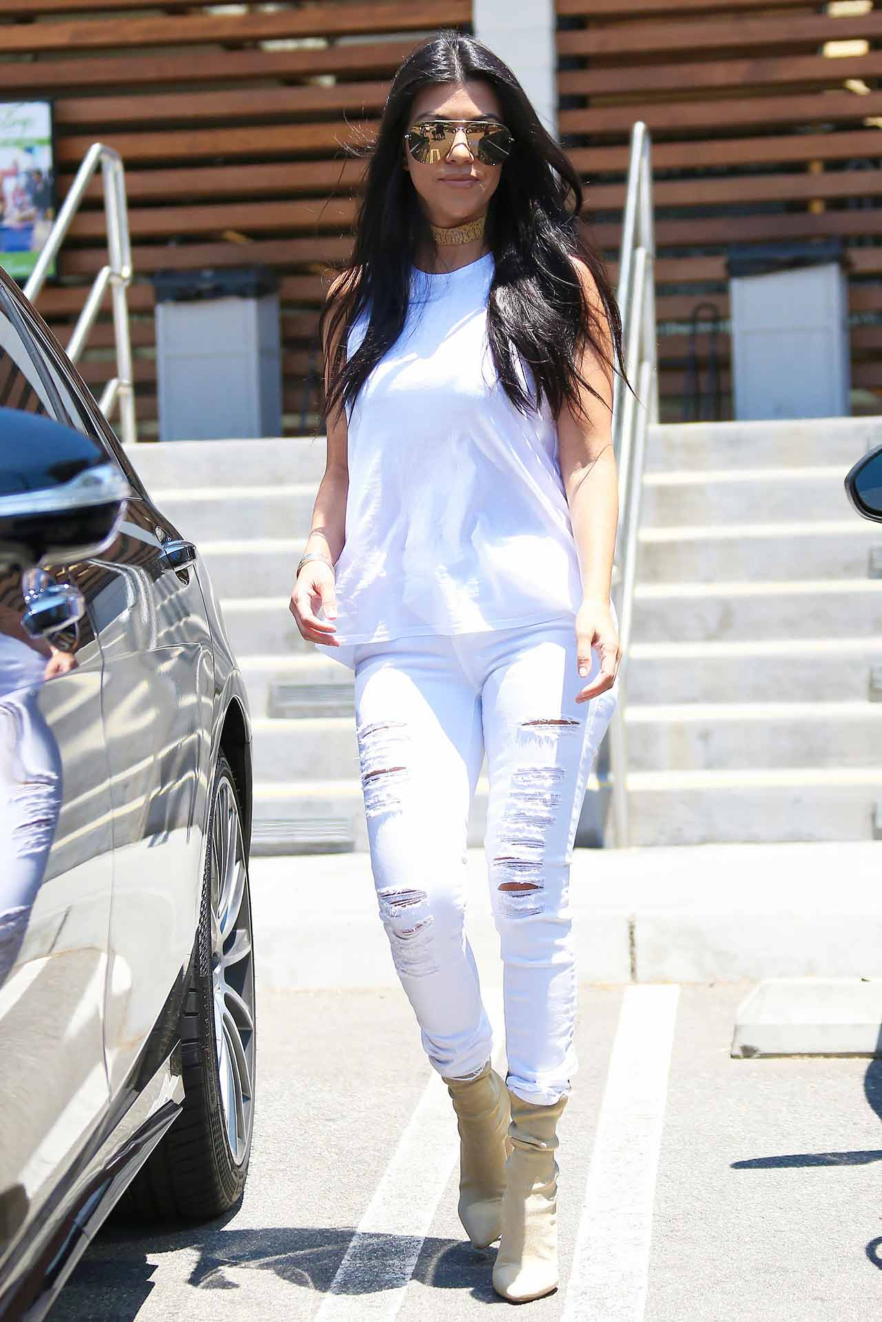 Kourtney Kardashian in FRAME Le Color Rip Jeans | The Jeans Blog
