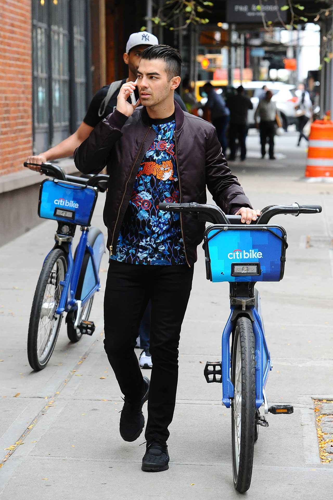 joe-jonas-black-j-brand-jeans-bike